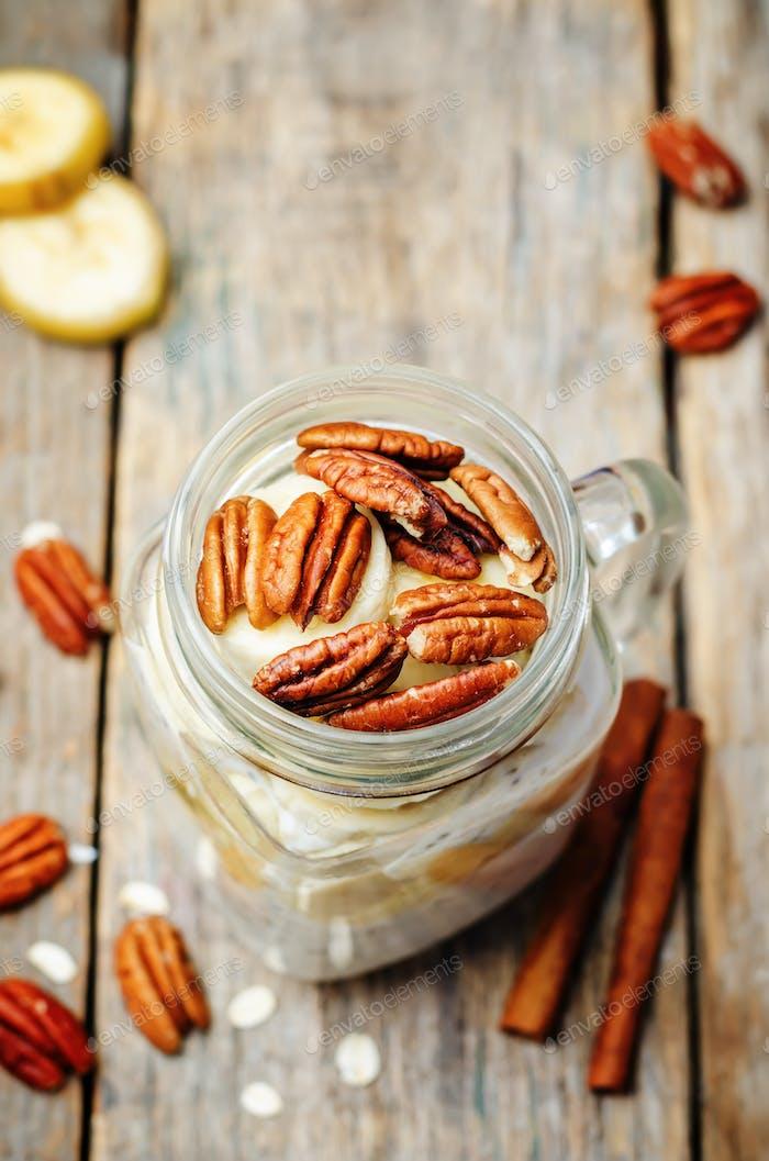 homemade healthy Chia seeds banana pecan overnight oatmeal in ja
