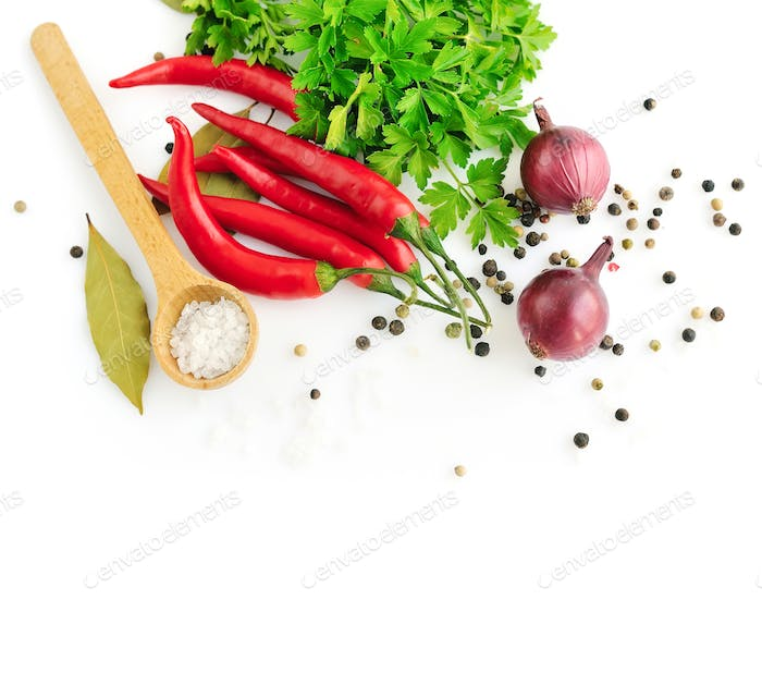 Parsley, garlic clove, onion,red pepper and spices on white back