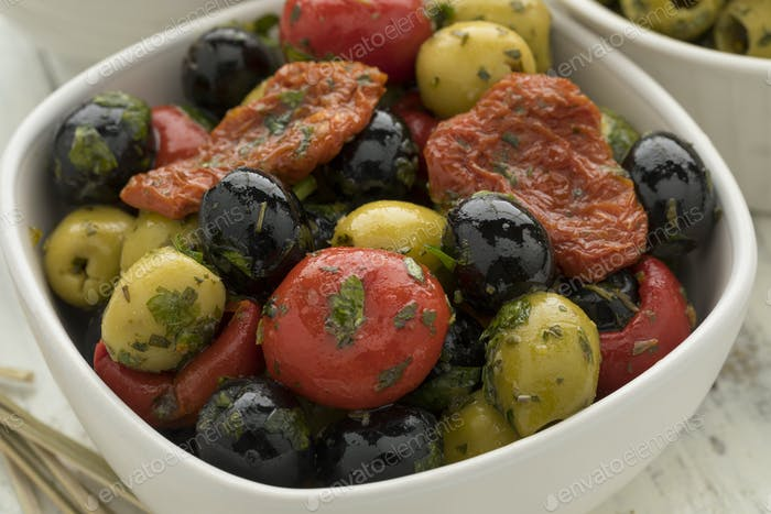 Bowl with green and black olives, peppers and tomatoes