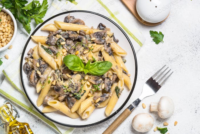 Pasta with mushrooms and spinach on white