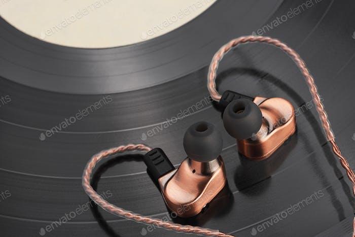 Hybrid ear-buds on the LP vinyl record.