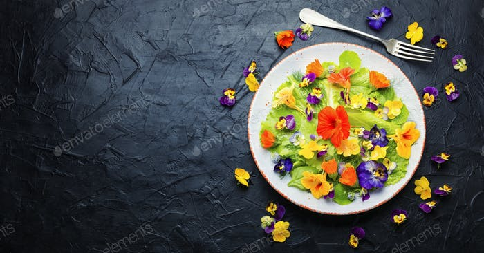 Edible flower salad in the plate