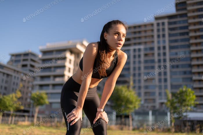 Young exhausted female resting during workout