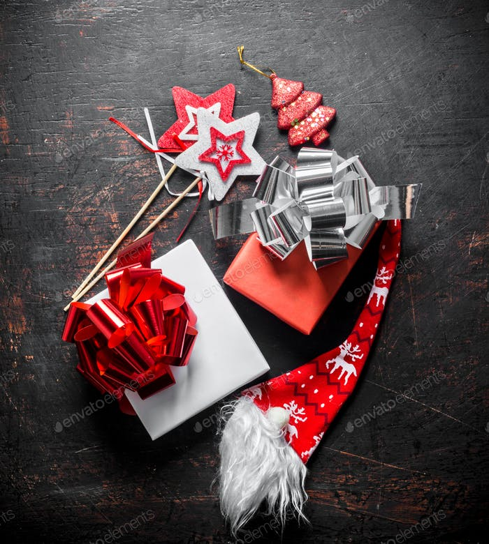 Christmas gifts in boxes with bows.
