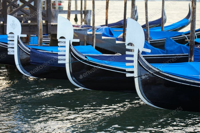Gondola boats moored in Grand Canal in the morning in Venice