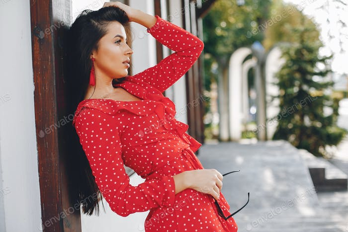 Elegant brunette in a summer city