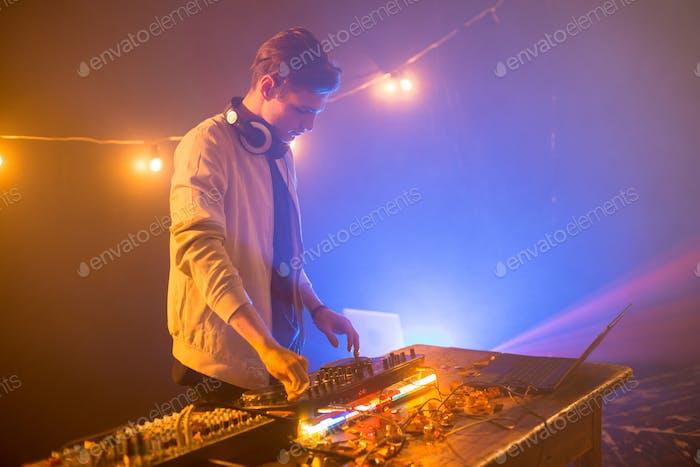DJ Playing Music at Mixer