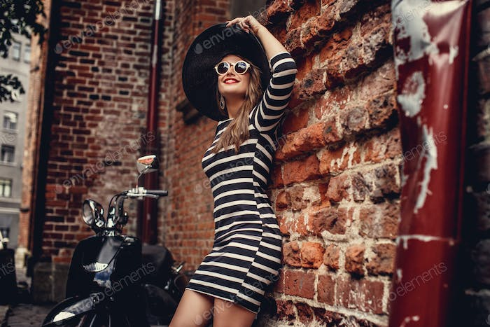 Fashion woman in dress with stripes.