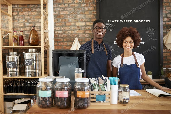 Portrait Of Male And Female Owners Of Sustainable Plastic Free Grocery Store
