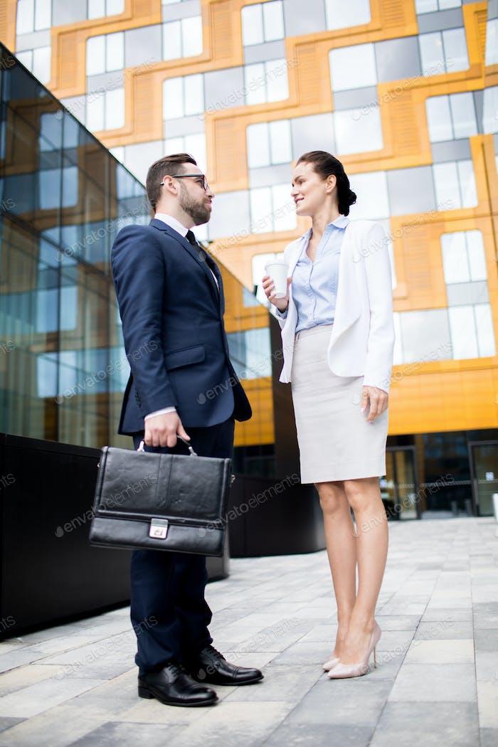 Business man and woman talking on break