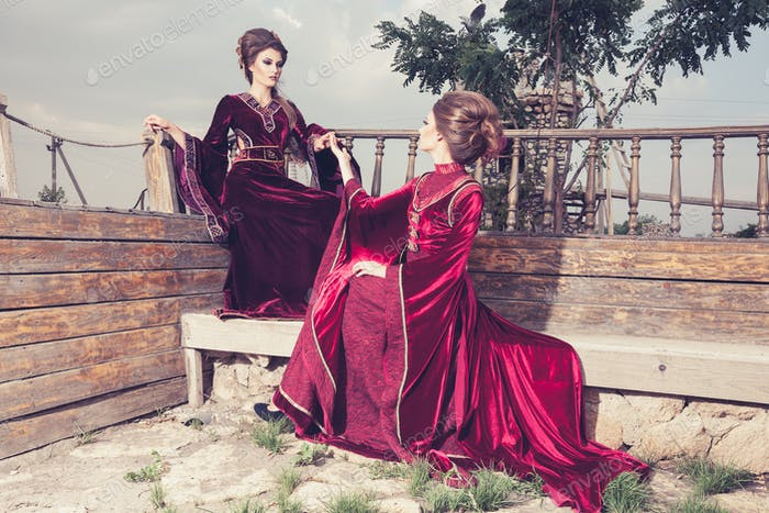 Two ladies in luxury vintage clothes on a boat