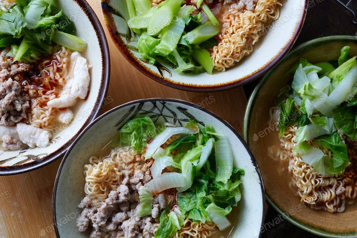 Cooked instant noodle in the bowls
