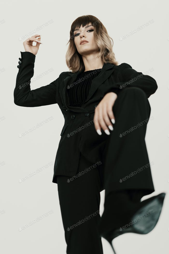 Portrait Bossy woman with attitude posing on white background