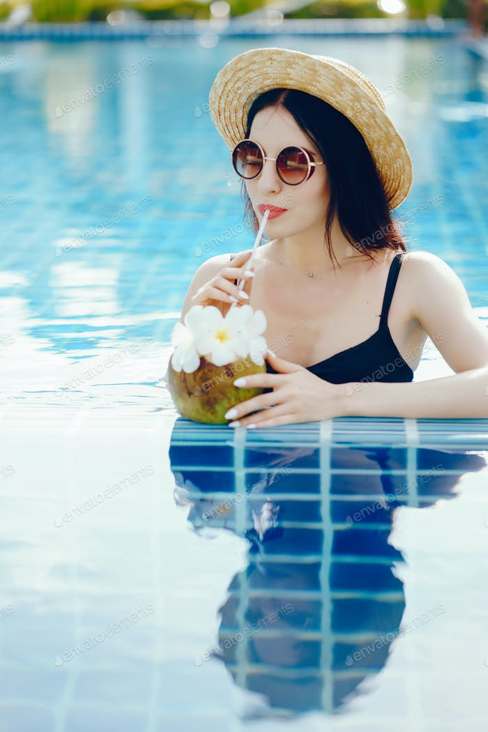brunette girl drinking coconut juice