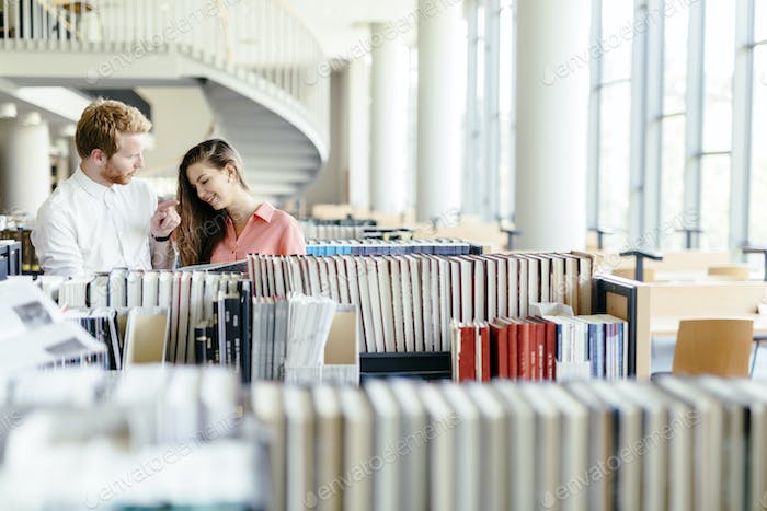 Two students reading and studying in library