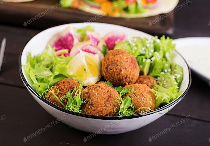 Falafel and fresh vegetables. Buddha bowl.