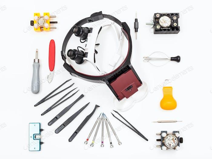verschiedene Instrumente für die Reparatur Uhr