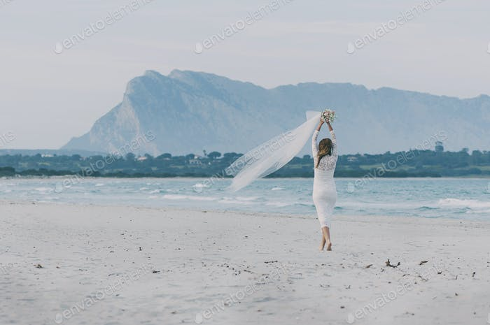 Happy amazing young woman in wedding dress