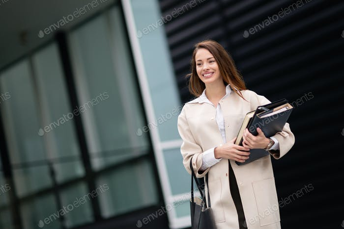 Beautiful businesswoman outdoors