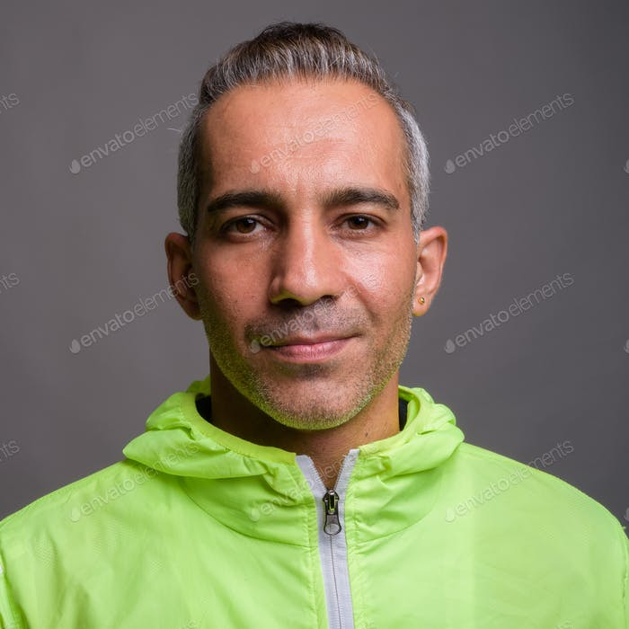 Handsome Persian man with gray hair wearing jacket