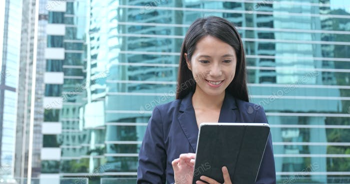Young Businesswoman use of tablet computer at central distinct in Hong Kong