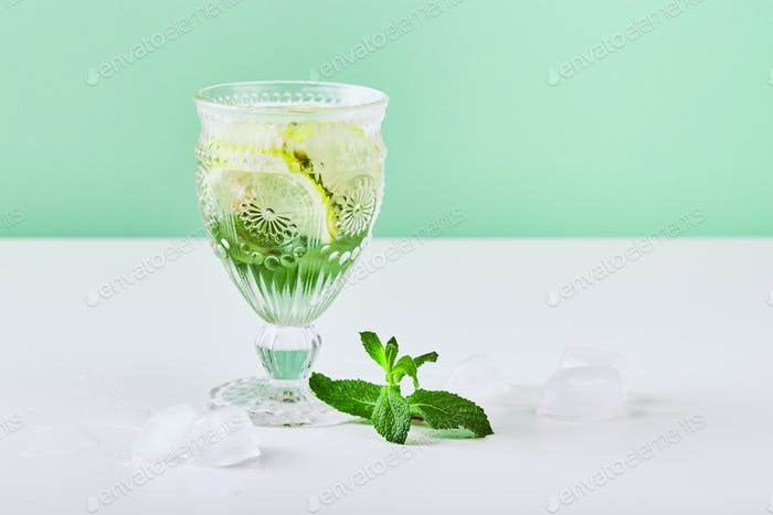 Fresh lemonade with mint and lemon in glasses