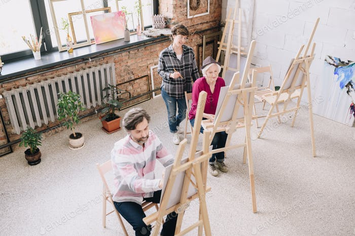 Adult Students in Modern Art Studio