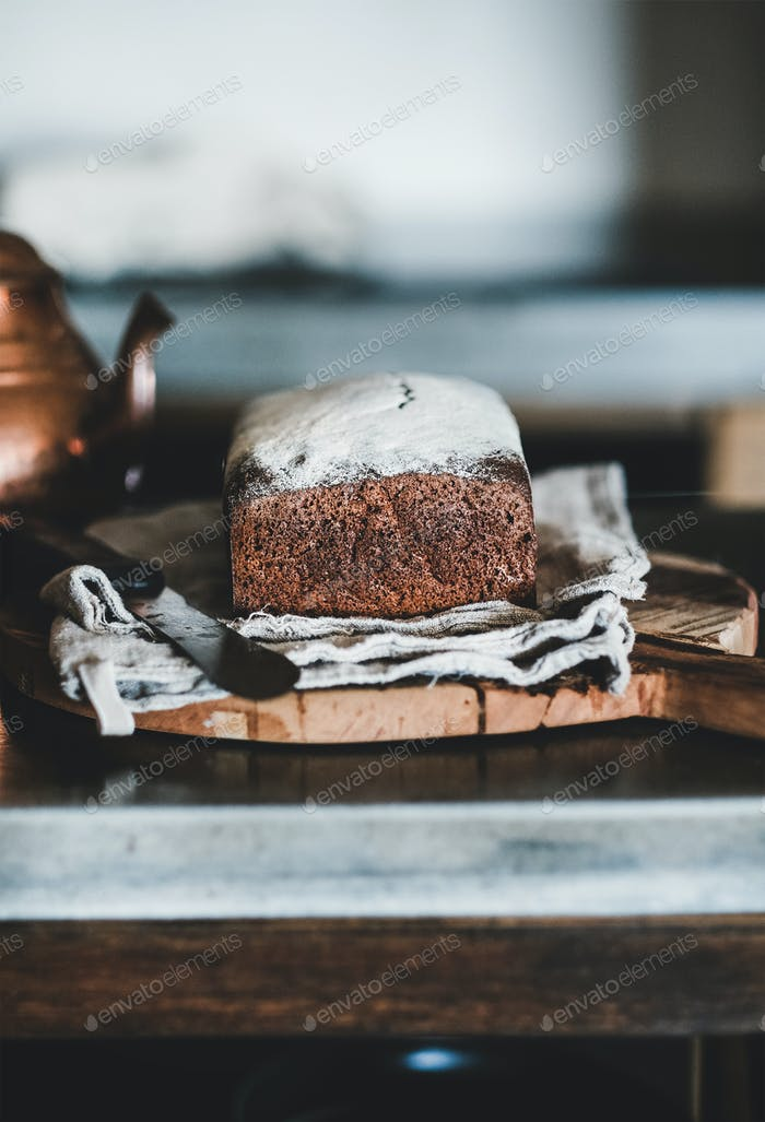 Healthy rye Swedish bread cut in slices on wooden board