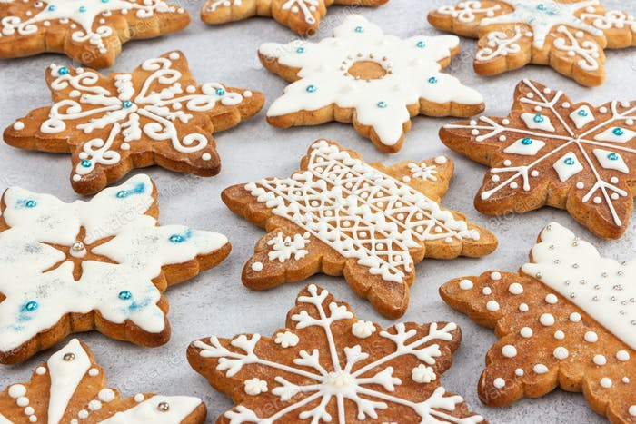 Christmas ginger cookies in the shape of snowflakes, decorated with various aisings