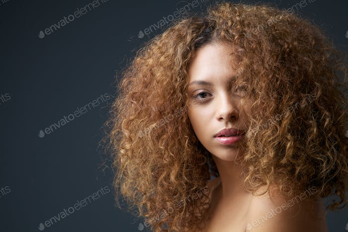 Beauty portrait of an attractive female fashion model with curly hair