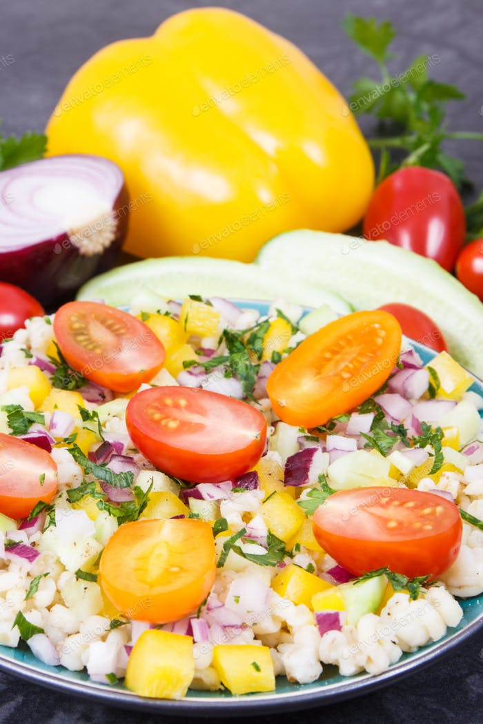 Salad with vegetables and bulgur groats. Healthy meal containing vitamins and minerals