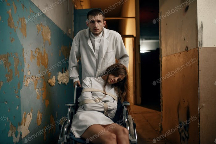 Male psychiatrist and female patient in wheelchair