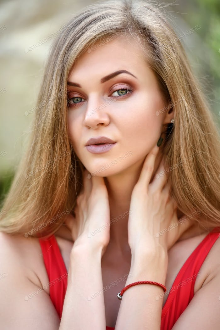 Portrait of beautiful young woman in red