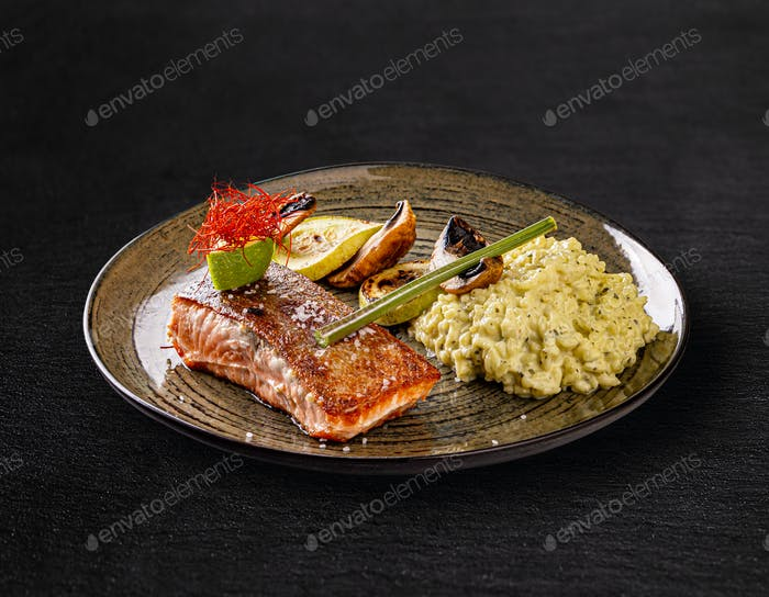 Grilled salmon served with vegetables