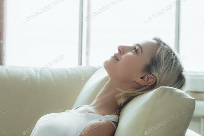Happy woman relax home alone. Casual natural female portrait home