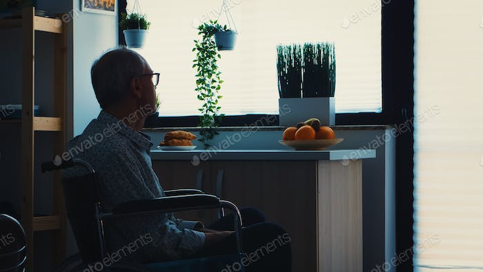 Lonely disabled pensioner in wheelchair