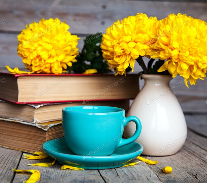 Flowers. Beautiful yellow chrysanthemum in a vintage vase. Cup of coffee. Bright Servais