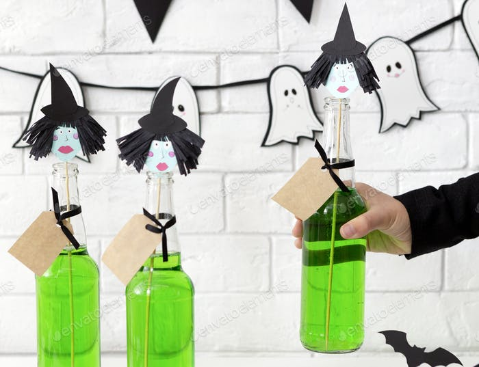 Close up of conceptual and creative green Halloween drinks