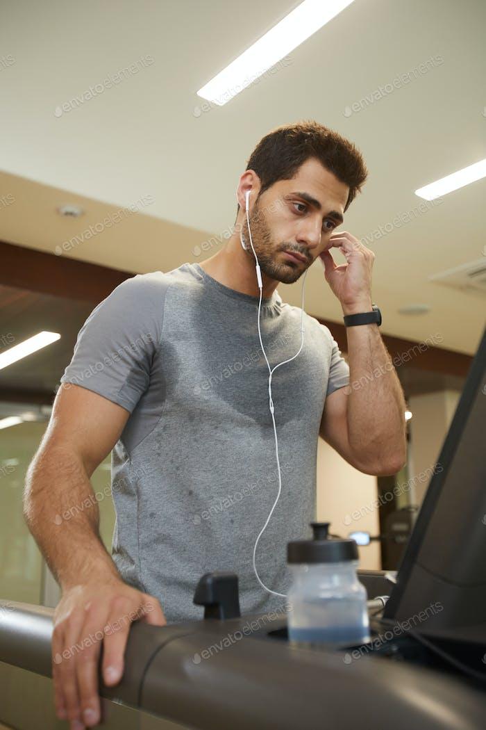 Sweaty Man Running on Treadmill