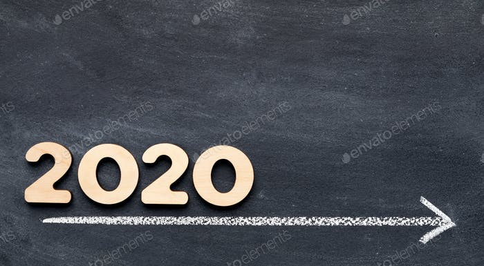 2020 concept on time line with arrow on chalk background