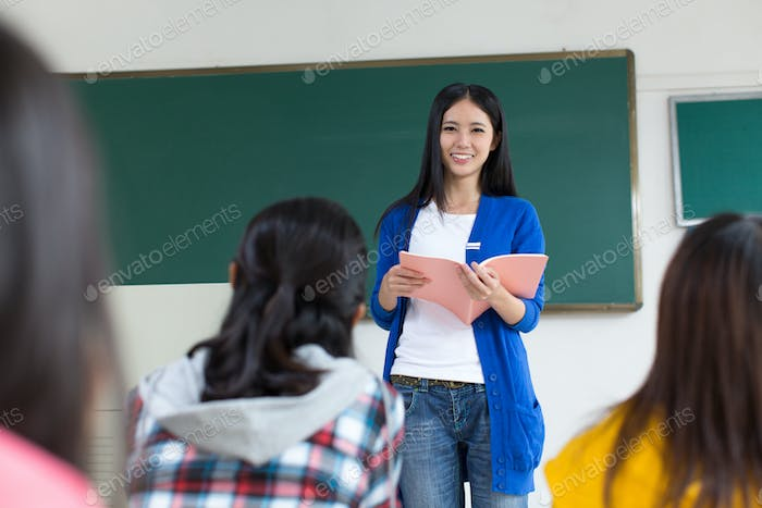 College teacher and students in the classroom