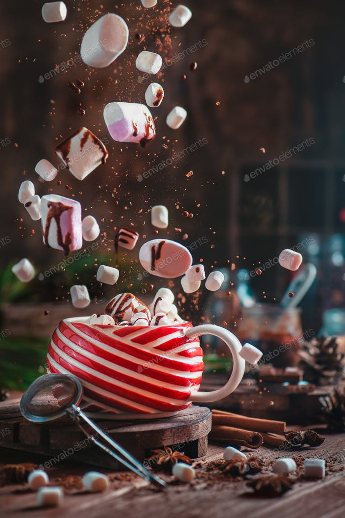 Christmas hot cocoa with flying marshmallows and chocolate. New Year celebration scene with
