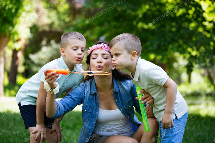 Happy young family enjoying picnic in nature