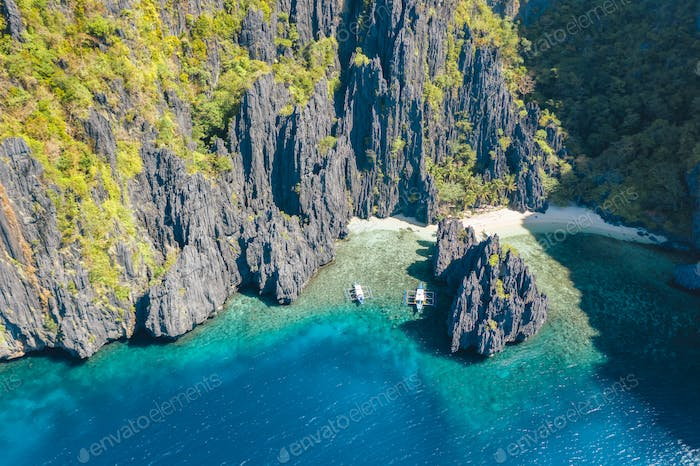 El Nido, Palawan, Philippines, aerial view of boats and rocky mountains scenery at Secret Lagoon