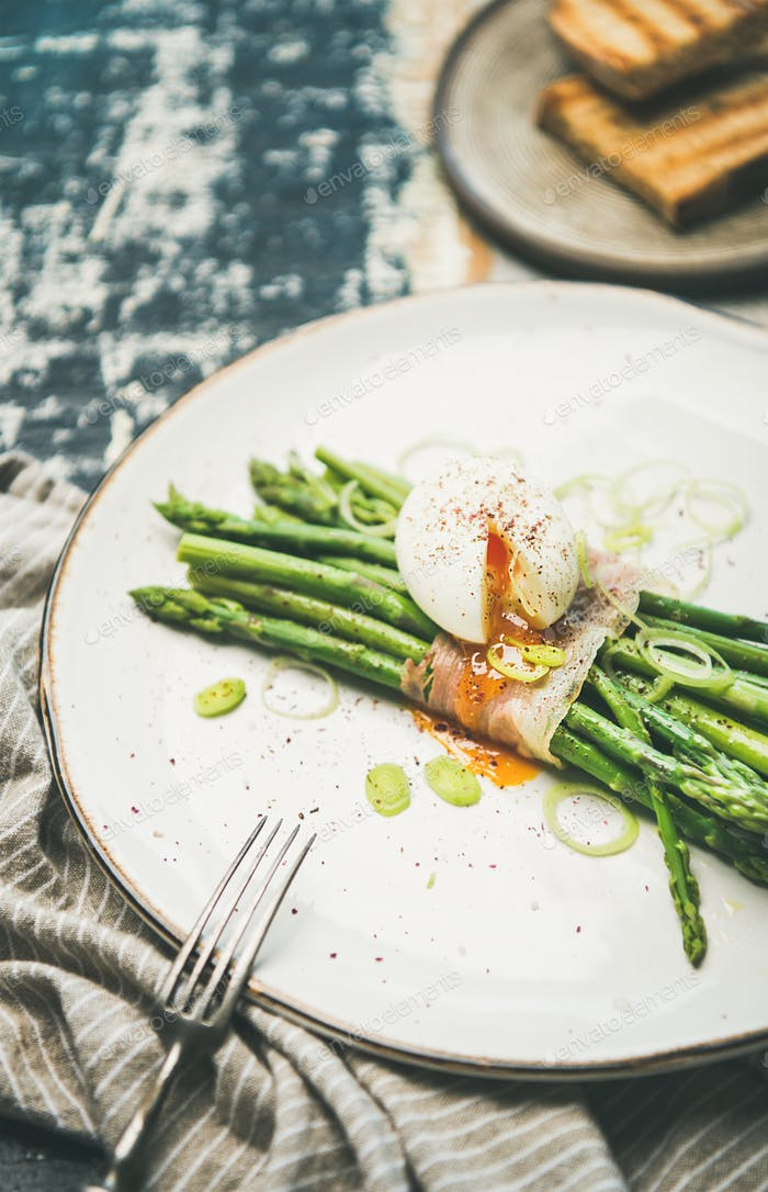 Green asparagus, soft-boiled egg , bacon and toasts, selective focus