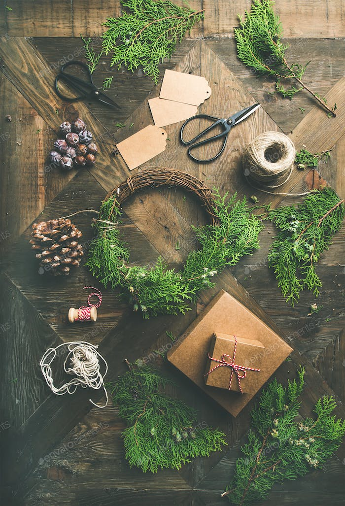 Flat-lay of Christmas and New Year decoration over wooden table