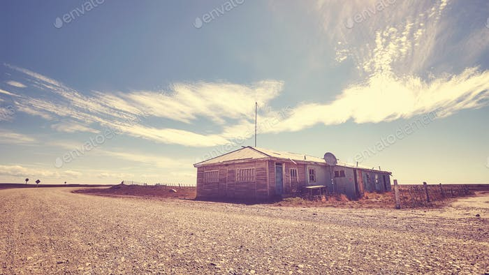 Abandoned house by a gravel road, Patagonia.