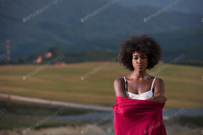 outdoor portrait of a black woman with a scarf