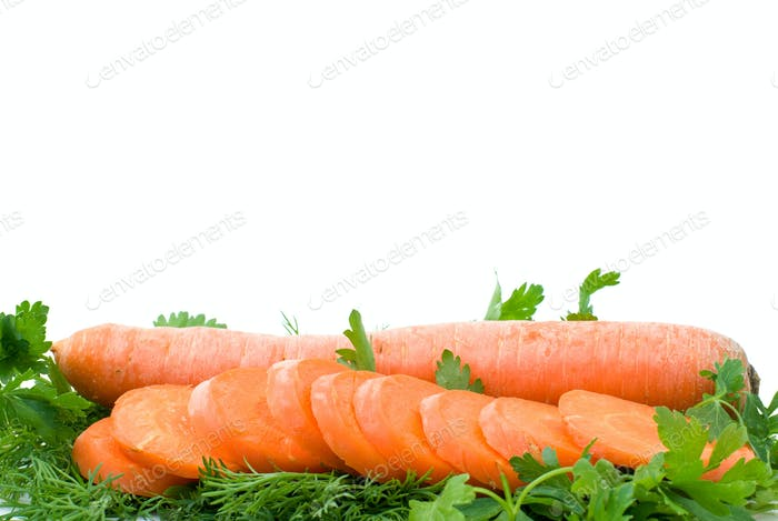 Ripe fresh long carrot and slices over some parsley