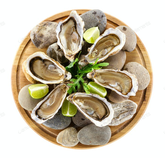 Fresh oysters on wooden board, with clipping path